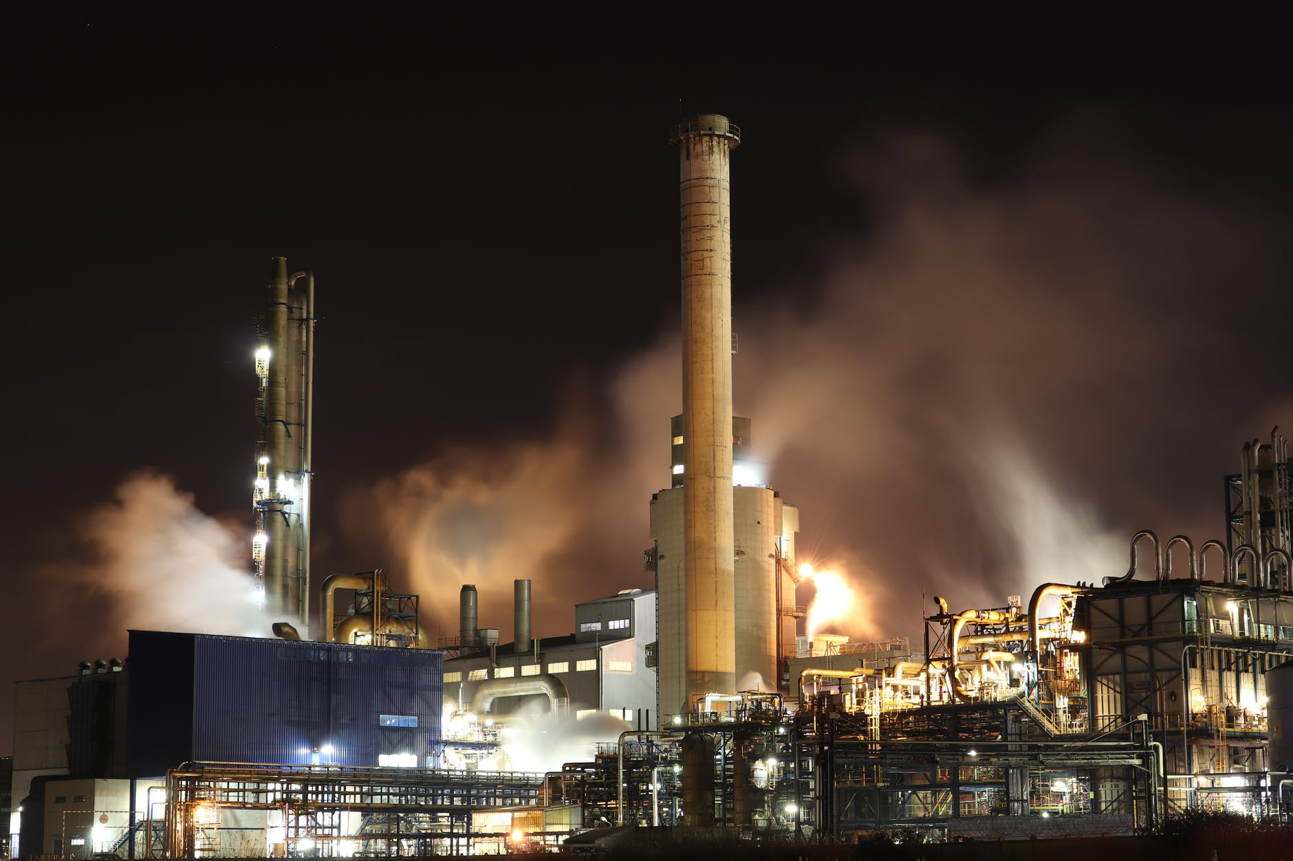 brown and white factory building during night time